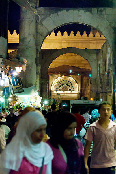 Crowd under the Roman arches in the suq in Damascus at night. The suq is very lively also after sunset.