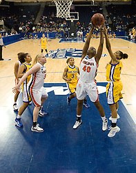Virginia guard Enonge Stovall (40) grabs a rebound from UCSB guard/forward Whitney Warren (2).  The #4 seed/#24 ranked Virginia Cavaliers defeated the #13 seed Santa Barbara Gauchos 86-52 in the first round of the 2008 NCAA Division 1 Women's Basketball Championship at the Ted Constant Convocation Center in Norfolk, VA on March 23, 2008