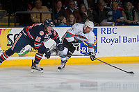 KELOWNA, CANADA - MARCH 5: Collin Shirley #15 of Kamloops Blazers stick checks Devante Stephens #21 of Kelowna Rockets on March 5, 2016 at Prospera Place in Kelowna, British Columbia, Canada.  (Photo by Marissa Baecker/Shoot the Breeze)  *** Local Caption *** Collin Shirley; Devante Stephens;