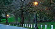 Two lights and white posts along Reservoir Loop Drive, Mount Tabor Park, Portland, Oregon USA.  Nikon MF Nikkor 105mm f/1.8 AIS.