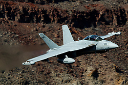 Boeing EA-18G Growler from the United States Navy VX-9 Vampires squadron (XE-500) flies low level through the Jedi Transition, Star Wars Canyon, Death Valley National Park, California, United States of America