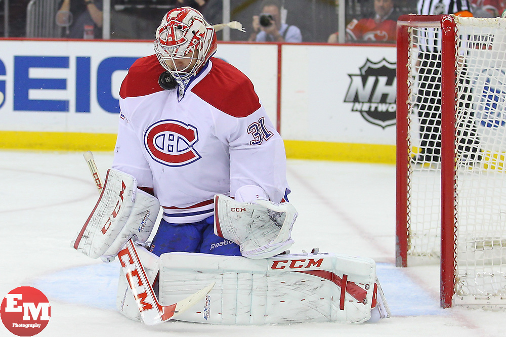 Apr 23, 2013; Newark, NJ, USA; Montreal Canadiens goalie Carey Price (31) makes a save during the second period of their game against the New Jersey Devils at the Prudential Center.