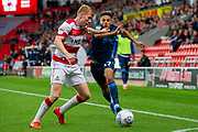 Tyler Smith of Bristol Rovers battles with Brad Halliday Of Doncaster Rovers during the EFL Sky Bet League 1 match between Doncaster Rovers and Bristol Rovers at the Keepmoat Stadium, Doncaster, England on 19 October 2019.