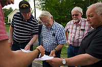 Andrew Kellar shows residents of Sterling Drive plans and answers questions on the proposed solar panels to be installed in the adjacent capped landfill on Friday afternoon. (l-r) Andrew Kellar NE Solar Garden, Dick Peterson, Duane Eppley, Dean Trefethen City Planning Director and Chandler Robinson.    (Karen Bobotas/for the Laconia Daily Sun)