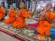 "06 APRIL 2015 - CHIANG MAI, CHIANG MAI, THAILAND: Newly ordained Buddhist novices participate in their first chanting service as monks during their ordination ceremony on the last day of the three day long Poi Song Long Festival in Chiang Mai. The Poi Sang Long Festival (also called Poy Sang Long) is an ordination ceremony for Tai (also and commonly called Shan, though they prefer Tai) boys in the Shan State of Myanmar (Burma) and in Shan communities in western Thailand. Most Tai boys go into the monastery as novice monks at some point between the ages of seven and fourteen. This year seven boys were ordained at the Poi Sang Long ceremony at Wat Pa Pao in Chiang Mai. Poy Song Long is Tai (Shan) for ""Festival of the Jewel (or Crystal) Sons.   PHOTO BY JACK KURTZ"