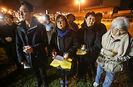 Supporters hold lit candles during a candlelight vigil in remembrance and support of 'Comfort Women', Japanese military sexual slavery victims during World War II, at Glendale Peace Monument on January 5, 2016 in Glendale, California. AFP PHOTO / Ringo Chiu