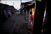 "At first light of dawn the sex workers face from their shacks, waiting for customers. Many of them have fled from their husbands, so sold as child brides. The young girls who are forced to marry face a number of problems, and often suffer health problems as a result of having sexual relations from an early age. These girls are being violated physically and emotionally. Child marriage was a major issue raised by the 2007 United Nations Commission on the Status of Women. A U.S. resolution to reduce the practice was passed, encouraging countries to take actions. In Ethiopia the legal age to get married is 18, the law quite often is ignored. Addis Ababa, Ethiopia, on friday, Febrary 20 2009.....In a tangled mingling of tradition and culture, in the normal place of living, in a laid-back attitude. The background of Ethiopia's ""child brides"", a country which has the distinction of having highest percentage in the practice of early marriages despite having a law that establishes 18 years as minimum age to get married. Celebrations that last days, their minds clouded by girls cups of tella and the unknown for the future. White bridal veil frame their faces expressive of small defenseless creatures, who at the age ranging from three to twelve years shall be given to young brides men adults already...To protect the identities of the recorded subjects names and specific places are fictional."