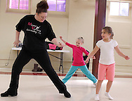 (from left) Andrea Nelson of Waynesville, Kiersten Bradley, 6 and Ava Stevens, 6 during the first of six hip-hop dance classes at the Carnegie Center in Miamisburg , Saturday, January 28, 2012.
