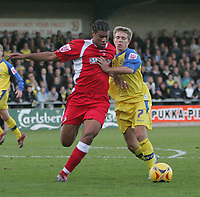 Photo: Lee Earle.<br /> Torquay United v Swindon Town. Coca Cola League 2. 18/11/2006. Swindon's Jerel Ifil (L) battles with Jamie Ward.