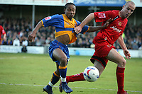 Photo: Rich Eaton.<br /> <br /> Shrewsbury Town v Milton Keynes Dons. Coca Cola League 2. Play off Semi Final, 1st Leg. 14/05/2007. Shrewsburys Derek Asamoah lefy beats Sean O'Hanlon to the ball