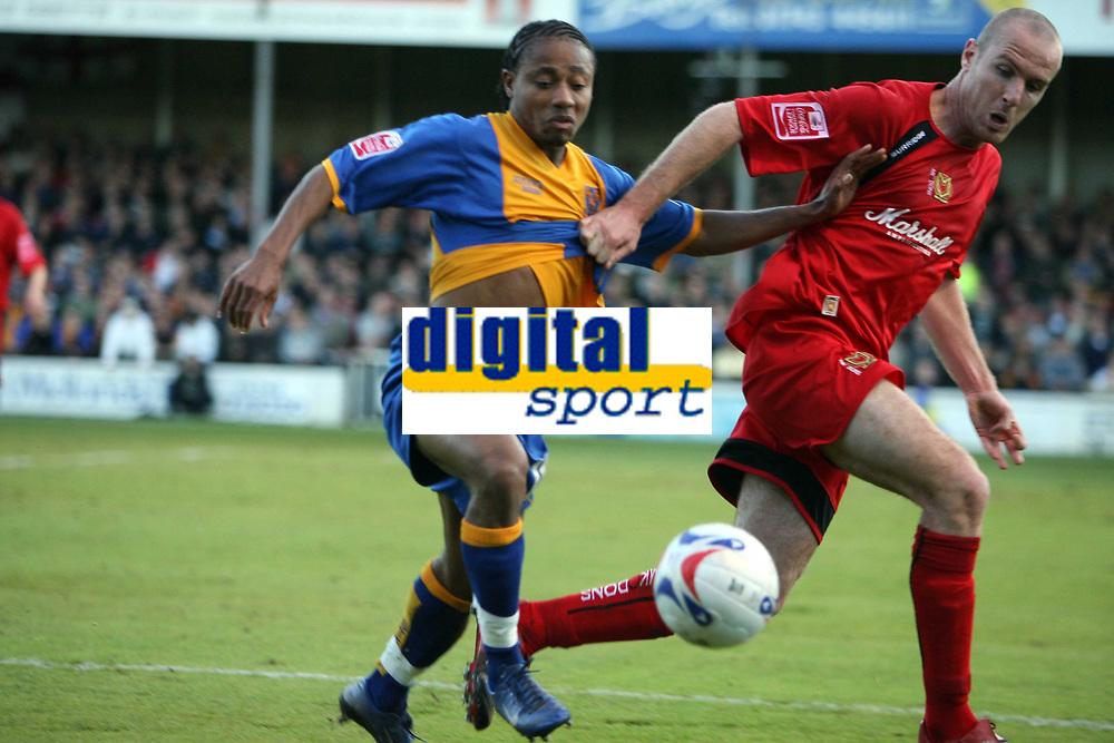 Photo: Rich Eaton.<br /> <br /> Shrewsbury Town v Milton Keynes Dons. Coca Cola League 2. Play off Semi Final, 1st Leg. 14/05/2007. Shrewsburys Derek Asamoah lefy beats Sean O'Hanlon to the ball
