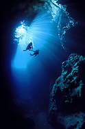 Two divers exploring Swallows Cave, Vava'u islands, Tonga.