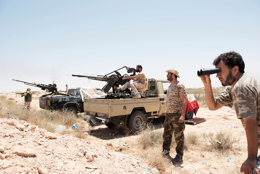 Libya: Libya's Government of National Accord's (GNA) fighters shoot with heavy machine gun at ISIS position in Sirte. Alessio Romenzi