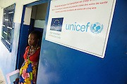 Rita Sahi, 25, who is 7-month pregnant with her third child, comes out of a prenatal consultation at the Libreville health center in Man, Cote d'Ivoire on Wednesday July 24, 2013.