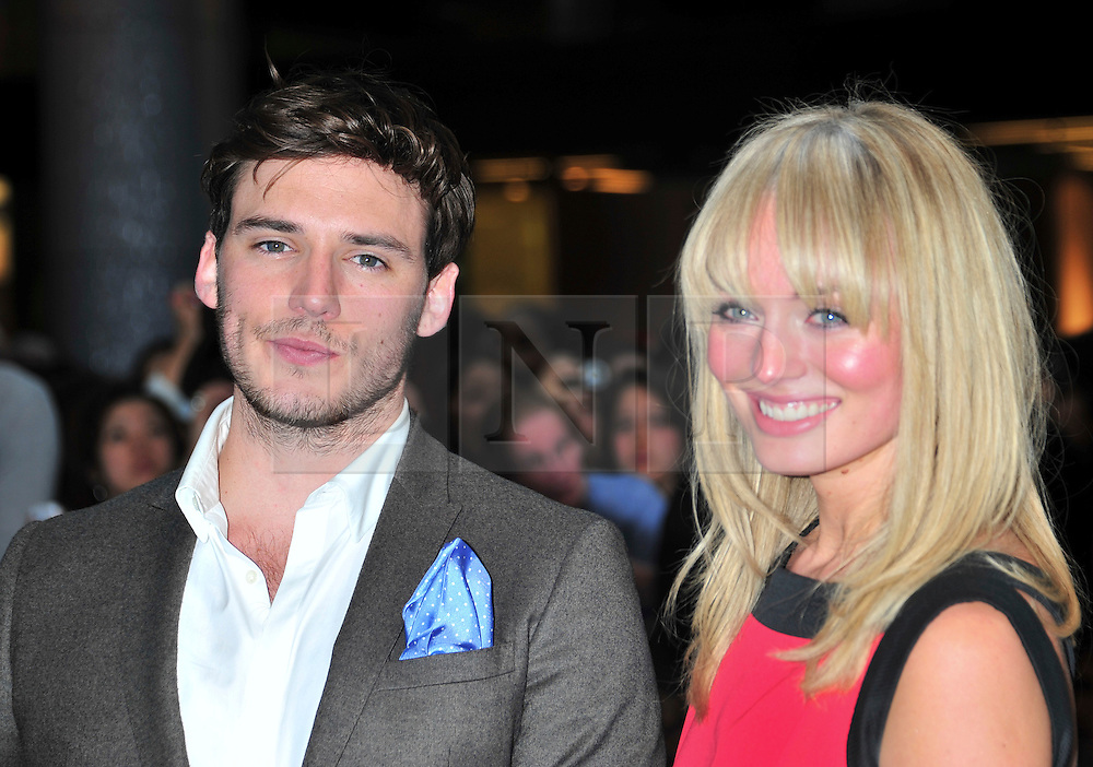 """© licensed to London News Pictures. London, UK  12/05/11Sam Claflin and Laura Haddock  attends the UK premiere of Pirates of the Carribean 4 """"on Stranger Tides"""" at Londons Westfield . Please see special instructions for usage rates. Photo credit should read AlanRoxborough/LNP"""