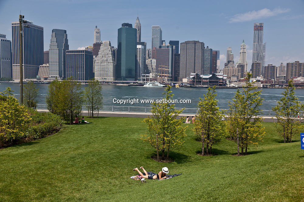 New York,  lower Manhattan cityscape view from Brooklyn bridge park pier 1 on East river New York - United states