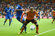 Wolverhampton Wanderers defender Barry Douglas (3) takes on Cardiff City midfielder Nathaniel Mendez-Laing (19) 0-0 during the EFL Sky Bet Championship match between Wolverhampton Wanderers and Cardiff City at Molineux, Wolverhampton, England on 19 August 2017. Photo by Alan Franklin.