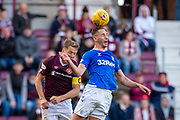 Nikola Katic (#19) of Rangers FC wins a header against Christophe Berra (#6) of Heart of Midlothian FC during the Ladbrokes Scottish Premiership match between Heart of Midlothian and Rangers FC at Tynecastle Park, Edinburgh, Scotland on 20 October 2019.