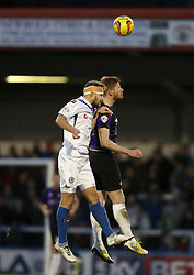 Bristol Rovers' Matt Harrold wins an aerial duel with Rochdale's Oliver Lancashire - Photo mandatory by-line: Matt Bunn/JMP - Tel: Mobile: 07966 386802 29/12/2013 - SPORT - FOOTBALL - Spotland Stadium - Rochdale - Rochdale v Bristol Rovers - Sky Bet League Two
