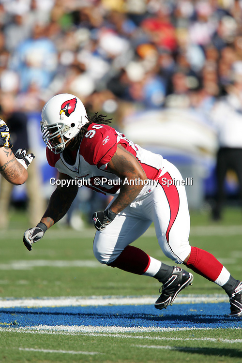SAN DIEGO - DECEMBER 31:  Defensive tackle Darnell Dockett #90 of the Arizona Cardinals rushes the passer against the San Diego Chargers at Qualcomm Stadium on December 31, 2006 in San Diego, California. The Chargers defeated the Cardinals 27-20 to secure the number one seed in the AFC playoffs. ©Paul Anthony Spinelli *** Local Caption *** Darnell Dockett