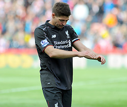 Liverpool's Steven Gerrard cuts a dejected figure after the final whistle is blown - Photo mandatory by-line: Nizaam Jones/JMP - Mobile: 07966 386802 - 24/05/2015 - SPORT - Football - Stoke - Britannia Stadium - Stoke City v Liverpool - Barclays Premier League