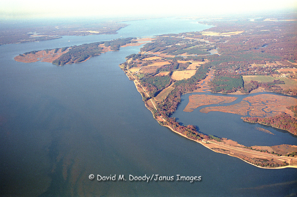 Aerial view: Jamestown Island in the distance on the James River. The Colonial Parkway running along the River.