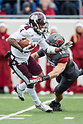 LITTLE ROCK, ARKANSAS - NOVEMBER 23:  Jameon Lewis #4 of the Mississippi State Bulldogs is tackled by Price Holmes #15 of the Arkansas Razorbacks at War Memorial Stadium on November 23, 2013 in Little Rock, Arkansas.  The Bulldogs defeated the Razorbacks 24-17.  (Photo by Wesley Hitt/Getty Images) *** Local Caption *** Jameon Lewis; Price Holmes