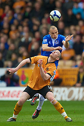 WOLVERHAMPTON, ENGLAND - Saturday, March 27, 2010: Everton's John Heitinga and Wolverhampton Wanderers' Christophe Berra during the Premiership match at Molineux. (Photo by David Rawcliffe/Propaganda)