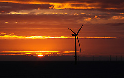 LNP Weekly Highlights 21/03/14 © Licensed to London News Pictures. 18/03/2014. Hampshire, UK. Sunrise over the Gwynt y Mor Offshore Wind Farm in North Wales this morning, 18th March 2014. Photo credit : Rob Arnold/LNP