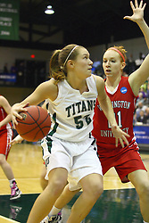 18 March 2011: Stacey Arlis heads for the goal guarded by Hannah Cusworth during an NCAA Womens basketball game between the Washington University Bears and the Illinois Wesleyan Titans at Shirk Center in Bloomington Illinois.