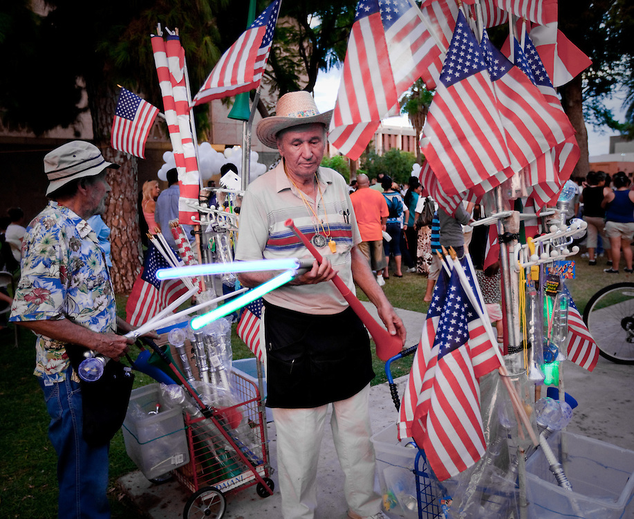 Vendors selling American Flags and toys.