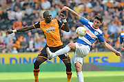 Alejandro Faurlin  and Mohamed Diame  during the Sky Bet Championship match between Hull City and Queens Park Rangers at the KC Stadium, Kingston upon Hull, England on 19 September 2015. Photo by Ian Lyall.