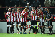 Brentford striker, Scott Hogan (9) scoring second 2-0 during the Sky Bet Championship match between Brentford and Cardiff City at Griffin Park, London, England on 19 April 2016. Photo by Matthew Redman.