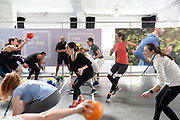 Fitbit Local Chicago Ambassador Jeremy Walton, center, leads #FitbitForAll dodgeball at the Fitbit launch event in New York, Monday, March 12, 2018. Fitbit unveiled its second smartwatch, Fitbit Versa, and first-ever device for kids, Fitbit Ace, along with the Fitbit family account and female health tracking. The newest devices and features from Fitbit support the company's vision of making the world healthier, while reaching more people in unique ways to continue to help them achieve their health and fitness goals. (Photo by Diane Bondareff/AP Images for Fitbit)