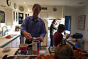26 OCTOBER 2010 - PHOENIX, AZ: Terry Goddard, his wife, Monica and their son, Kevin, have breakfast in their home in central Phoenix. Goddard lost the election to sitting Governor Jan Brewer, a conservative Republican.     PHOTO BY JACK KURTZ