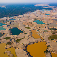 Aerial drone photographs showing the extent of the deforestation impact from alluvial gold mining on the tropical forests of the Madre de Dios region. The ponds took water from local rivers and wetlands for liquifying and sorting soil to extract gold. This also impacted trees near the cleared areas due to the dramatic changes in the watertable. Following Peru's February 2019 militarized crackdown on illegal and unofficial alluvial gold mining in the La Pampa region of Madre de Dios, Wake Forest University's Puerto Maldonado-based Centro de Innovación Científica Amazonia (CINCIA), a leading research institution for the development of technological innovation for biological conservation and environmental restoration in the Peruvian Amazon, is applying years of scientific research and technical experience related to understanding mercury contamination and managing Amazonian ecosystems. What they learn will help guide urgent remediation, restoration, and reforestation efforts that can also serve as models for how we address the tropic's most dramatically devastated landscapes around the world. La Pampa, Madre de Dios, Peru.