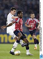 FOOTBALL - FRENCH CHAMPIONSHIP 2007/2008 - L1 - LILLE OSC v SM CAEN - 15/03/2008 - JEAN MAKOUN (LIL) / GREGORY LECA (CAEN) - PHOTO CHRISTOPHE DUPONT ELISE / FLASH PRESS