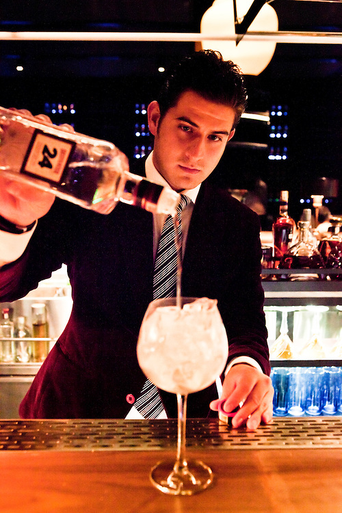 Hektor Monroy (bar manager) at Unico, makes a gin and tonic garnished with coriander and whole juniper berries.