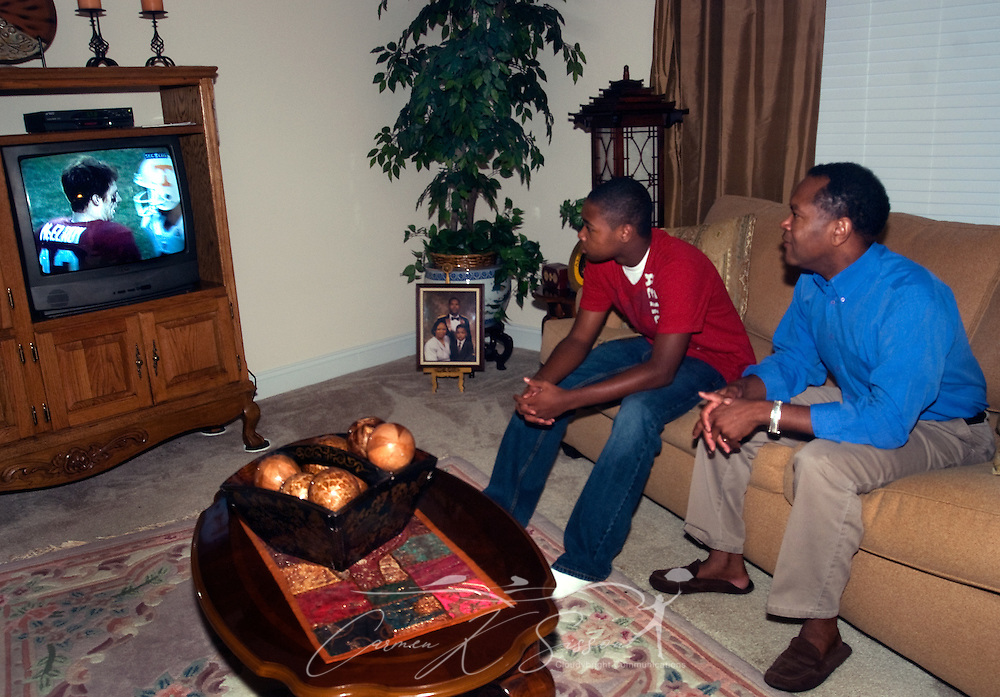 Levern Eady and his son, Matthew, watch the Alabama-Tennessee football game at their home in Madison, Ala. Oct. 27, 2009. Mr. Eady says he  chose to relocate to the Huntsville metropolitan area for the intellectually-rich environment it provides for his children as well as its future economic potential. Analysts expect Huntsville to fare well in the new economy thanks to its strong aerospace, defense, and biotech industries. (Photo by Carmen K. Sisson/Cloudybright)