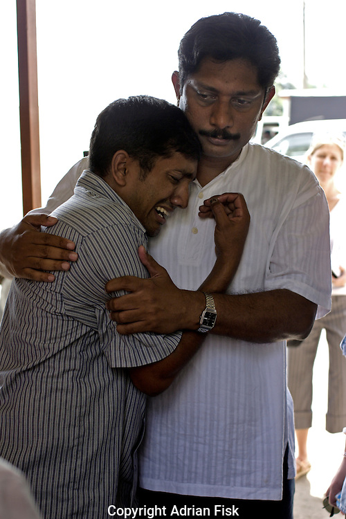 Oxfam worker Cherian comforts 26 yr old Arsela Abeytunga whose father and brother were killed by the Tsunami.