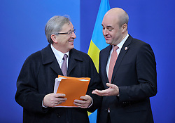 Jean-Claude Juncker, Luxembourg's prime minister, left, arrives for the European Union Summit and is greeted by Fredrik Reinfeldt, Sweden's prime minister and standing president of the European Council, at the EU headquarters in Brussels, Belgium, on Thursday, Nov. 19, 2009. European leaders will try to set divisions aside today as they choose their first-ever European Union president to represent the 27-nation bloc on the world stage. (Photo © Jock Fistick).
