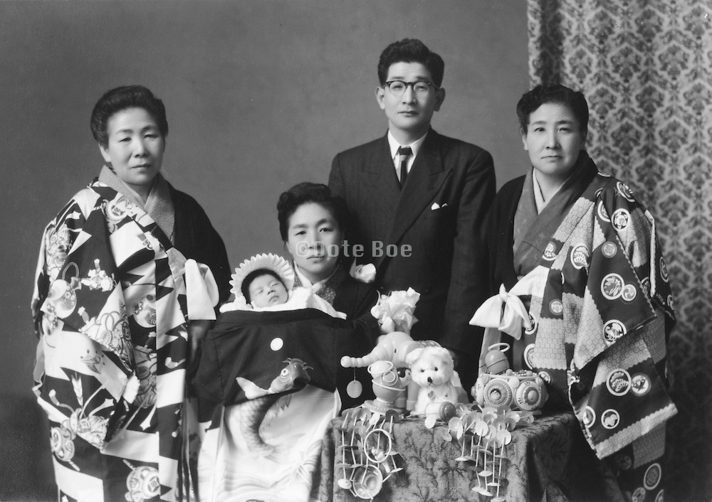 formal portrait of Japanese family with new born baby 1965