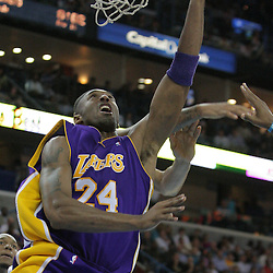 12 November 2008:  Los Angeles Lakers guard Kobe Bryant (24) shoots past Tyson Chandler (6) during a 93-86 win by the Los Angeles Lakers over the New Orleans Hornets at at the New Orleans Arena in New Orleans, LA..