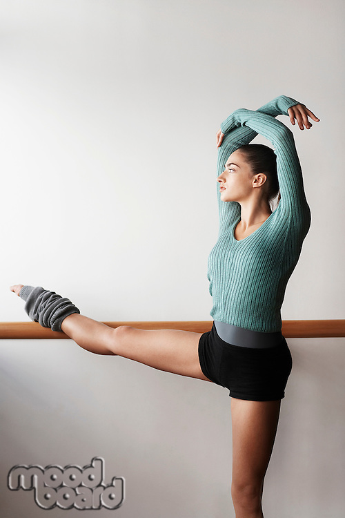 Ballet Dancer Stretching at bar