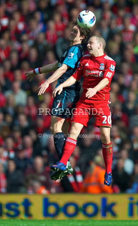 LIVERPOOL, ENGLAND - Saturday, March 3, 2012: Liverpool's Jay Spearing and Arsenal's Tomas Rosicky during the Premiership match at Anfield. (Pic by David Rawcliffe/Propaganda)