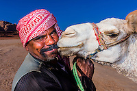 Bedouin man and his camel in the Arabian Desert, Wadi Rum, Jordan.