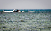 A sailboat capsized near Kahala, Oahu, Hawaii.