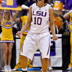 February 5, 2011; Baton Rouge, LA; LSU Lady Tigers guard Adrienne Webb (10) celebrates following a win over the Kentucky Wildcats in a game at the Pete Maravich Assembly Center. LSU defeated Kentucky 61-51.  Mandatory Credit: Derick E. Hingle-US PRESSWIRE