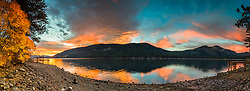 """Donner Lake Sunrise 18"" - Stitched panoramic sunrise photograph of a vibrant orange sunrise, docks, and a bush with Fall colors at Donner Lake in Truckee, California."