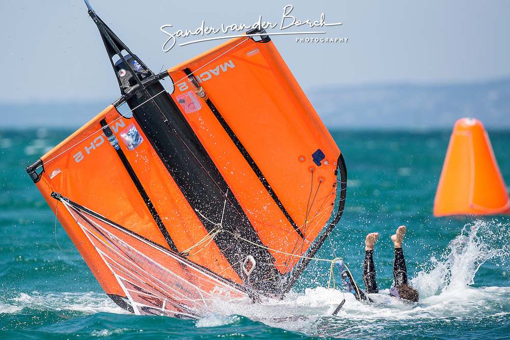 Moth dingy capsizes and the helmsman, Scott Cotton falls in the water in spectaculair style.<br /> <br /> Day 2 of the McDougall + McConaghy 2015 Moth Worlds, Sailing Anarchy and Sperry Top-Sider Moth Worlds coverage 2015, Sorrento, Australia. January 11th 2015. Photo &copy; Sander van der Borch.